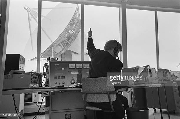 Staff in the equipment rooms overlooking the Doppler weather radar with 25 metre antenna at Chilbolton Observatory Hampshire England13th April 1967