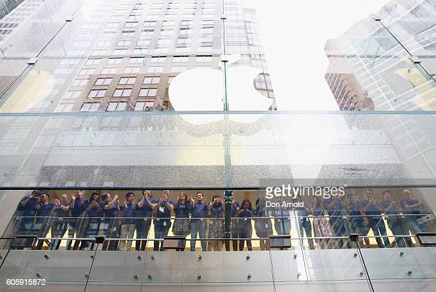 Staff inside the store look on as the crowd outside waits in anticipation for the release of the iPhone 7 at Apple Store on September 16 2016 in...