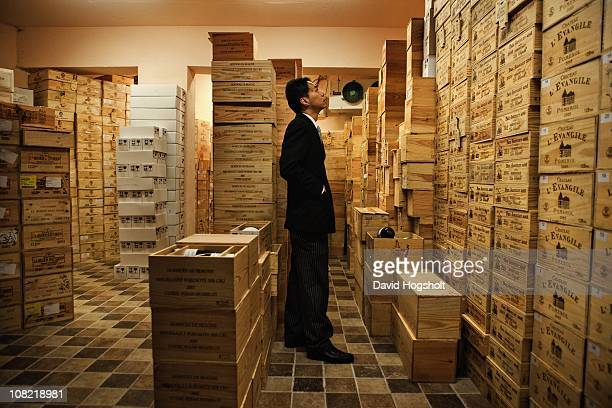 A staff looking at 'La Chapelle' crates August 4 2009 in the cellar of a private wine collector in Hong Kong Brand ambassador and world class...