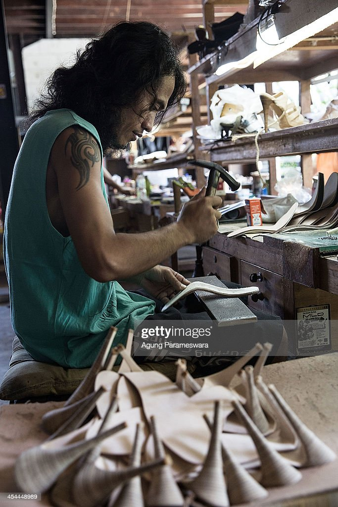 A staff makes a part of high heels at Niluh Djelantik atelier on November 12, 2013 in Canggu Village, Bali, Indonesia. Niluh Djelantik (formerly called Nilou), the hand made high end leather shoe, is produced by Balinese shoe lover and designer Ni Luh Ayu Pertami with 40 shoes designers and workers in a small atelier at Canggu Village. This brand signature by a unique engraving and designed to be comfortable high heels or wedges with elegan touch. Celebrities like Cate Blanchett, Uma Thurman, Julia Roberts, Paris Hilton, Cameron Diaz and American top model Gisele Bundchen have been known to purchase Niluh Djelantik beautiful shoes and sandals.