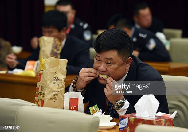 A staff member at the Zhongnanhai leadership compound eats McDonalds for dinner while US President Barack Obama has a private dinner with Chinese...