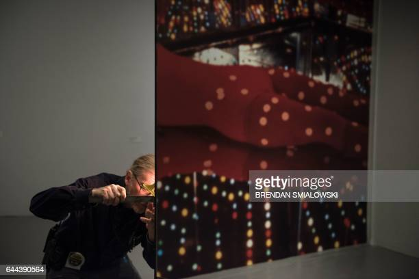 A staff member checks to see if a window into the Love Forever room is level during a preview of the Yayoi Kusama's Infinity Mirrors exhibit at the...