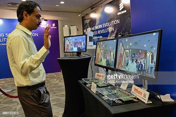 A staff member demonstrates video capture on a 5G radio testbed achieving a peak throughput of 275 gigabits per second and latency as low as 2ms in...