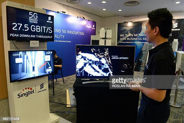 A staff member demonstrates video streaming at the maximum 275 bigabits per second peak downlink throughput connecting to a 5G radio testbed in...