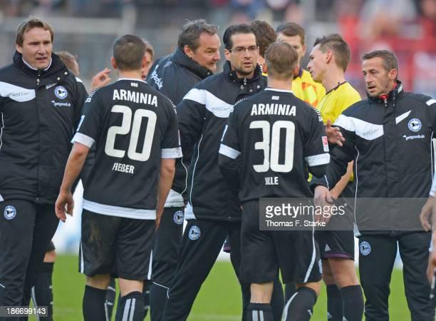 Staff member Dirk Westerhold goalkeeper coach Marco Kostmann physiotherapist Sven Bockermann and assistant coach Nils Haacke of Bielefeld hinder...