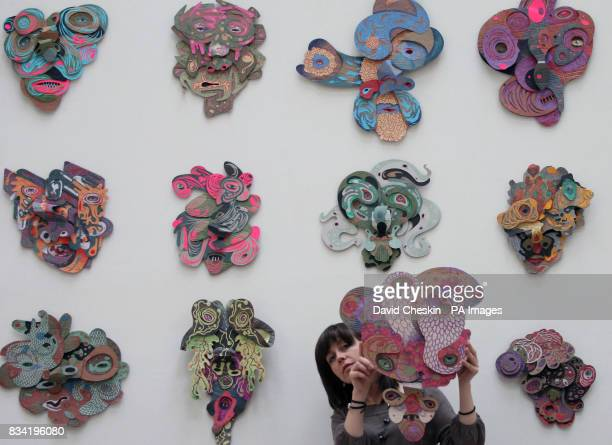 Staff member Donna Hainan puts the finishing touches to an exhibition of more than 50 masks based on the face of the Elephant Man John Merrick at the...