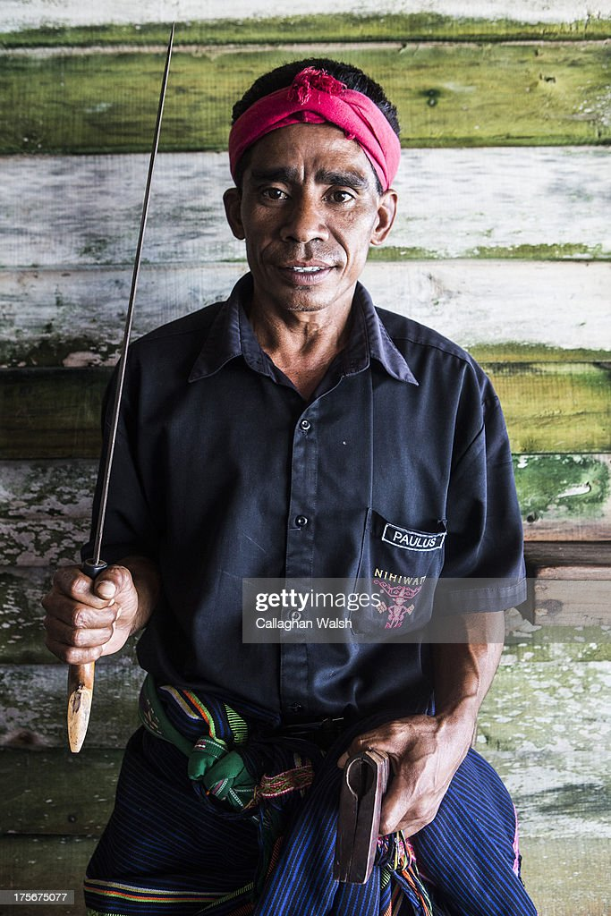 A staff member from Nihiwatu Resort poses whilst holding a traditional Sumbanese machete in Western Sumba on April 12, 2013. Sumba is a remote island in Eastern Indonesia, part of the Lesser Sunda Islands group based in the province of East Nusa Tenggara.