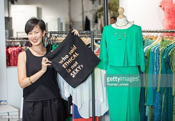 A staff member of the label 'Inheels' presents a bag with the slogan 'who said ETHICAL is not sexy' at the Ethical Fashion Show Berlin during the...