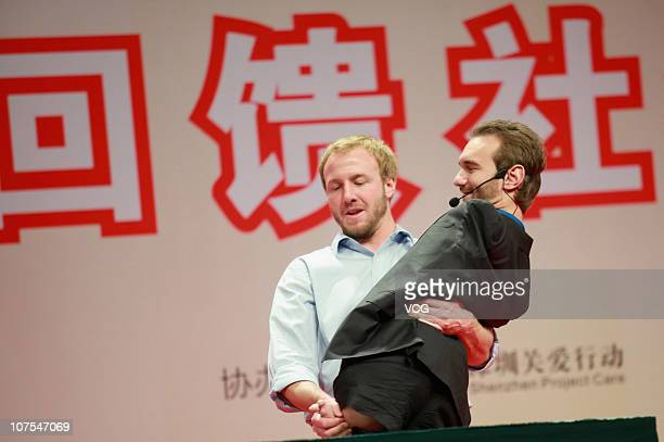 A staff member picks up Australian preacher and motivational speaker Nick Vujicic ahead of his public lecture at Citizen Center Hall on December 12...