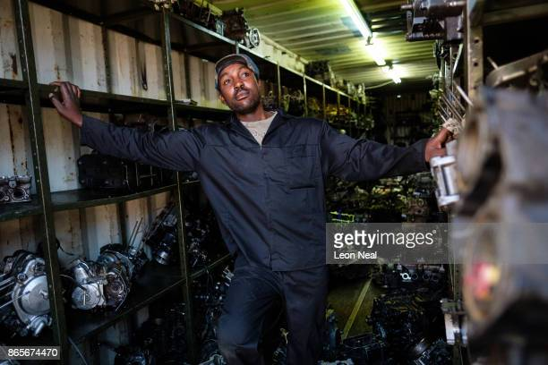 Staff member 'Rasta' stands inside a shipping container of used engine components at 'The Bike Hospital' on October 18 2017 in Johannesburg South...