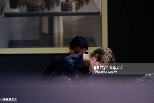 A staff member services customers at the Lindt Cafe in Martin Place on March 20 2015 in Sydney Australia The cafe reopened to the public today three...