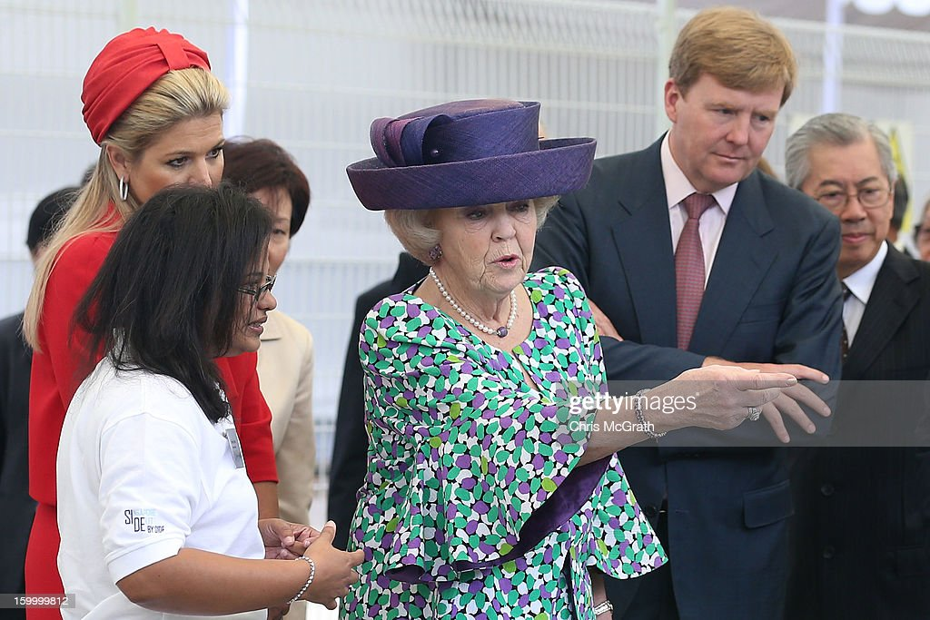 A staff member shows a off a research project to Princess Maxima, Prince Willem-Alexander and Queen <a gi-track='captionPersonalityLinkClicked' href=/galleries/search?phrase=Beatrix+of+the+Netherlands&family=editorial&specificpeople=92396 ng-click='$event.stopPropagation()'>Beatrix of the Netherlands</a> during a tour the Van Kleef Centre, which houses the NUS Aquatic Science centre on January 25, 2013 in Singapore, Singapore. Queen Beatrix is on a three day state visit to Singapore.