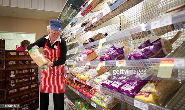 A staff member stacks loaves of bread onto shelves at a Wesfarmers Ltd Coles supermarket in Sydney Australia on Thursday July 28 2011 Wesfarmers Ltd...