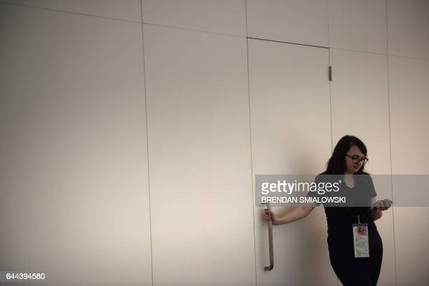 A staff member waits to open a door during timed experiences of mirror rooms during a preview of the Yayoi Kusama's Infinity Mirrors exhibit at the...