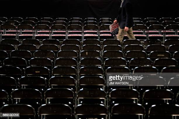 A staff member walks through the aisles with Democratic Senatorial candidate Doug Jones placards as they prepare for a rally in Birmingham Alabama on...
