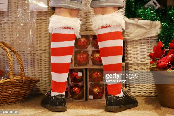 A staff member wears Christmas theme socks on December 16 2013 in Melbourne Australia