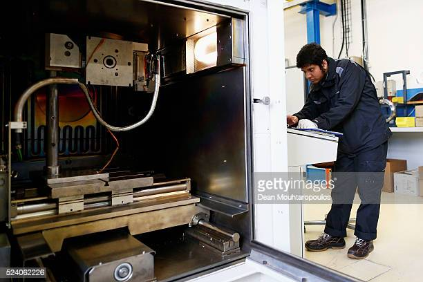 A staff member works in Building 72 the Mechanical Materials Engineering Department or MME workshop at The European Organization for Nuclear Research...