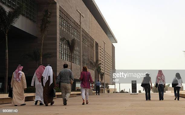 Staff members and students walk on campus at the King Abdullah University of Science and Technology on October 13 in Thuwal 80 kilometers north of...