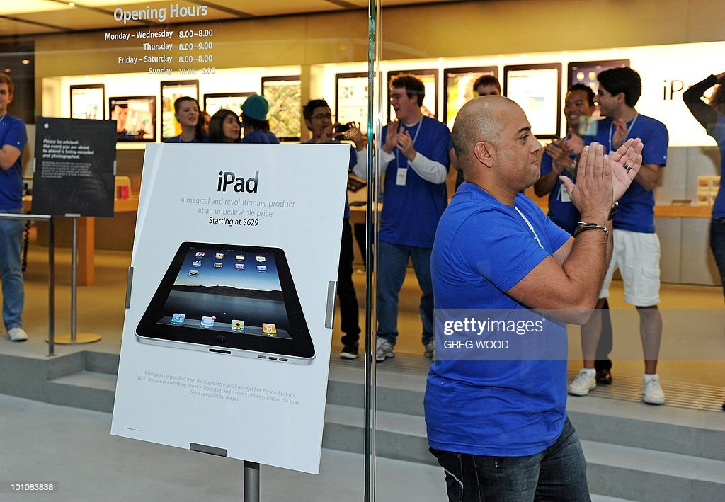 Staff members cheer inside Apple's flagship store in Sydney on May 28, 2010 just prior to the much-hyped iPad going on sale. The iPad -- a buttonless tablet computer targeted at the leisure market -- is also going on sale in Japan, Britain, Canada, France, Germany, Italy, Japan, Spain and Switzerland on May 28 as part of a staggered global roll-out. AFP PHOTO / Greg WOOD