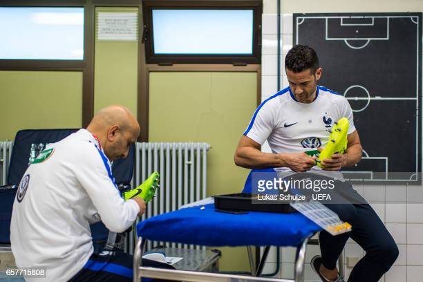 Staff members of team France prepare the shoes of the players prior to the FIFA 2018 World Cup Qualifier between Luxembourg and France at Stade Josy...