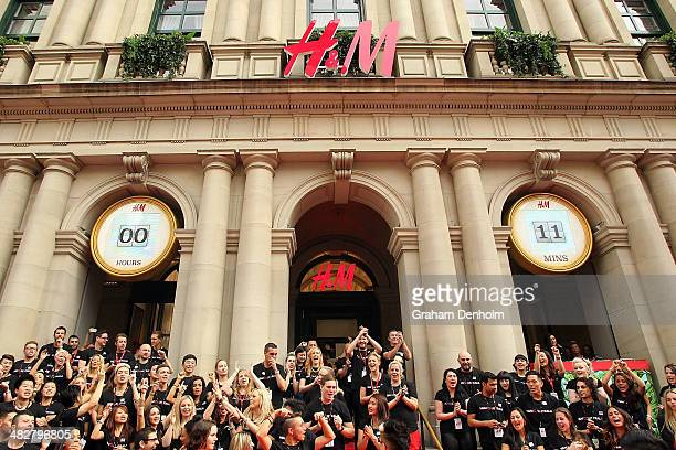 M staff members perform outside the GPO building during the countdown to the opening of the first HM Australia store at the GPO on April 5 2014 in...