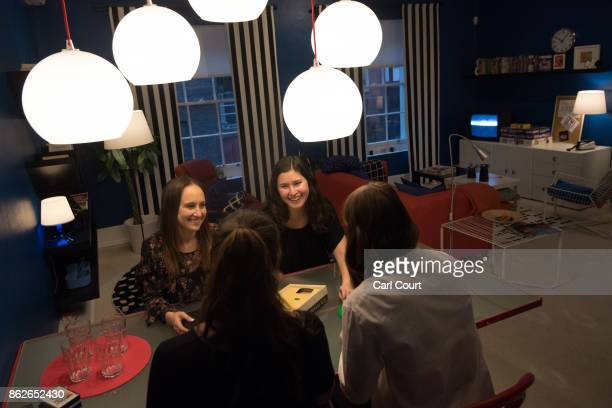 Staff members pose for a photograph in the 'Nineties Room' of the IKEA house on October 17 2017 in London England The room is in the 'IKEA House...