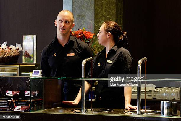 Staff members prepare at the Lindt Cafe in Martin Place on March 20 2015 in Sydney Australia The cafe reopened to the public today three months after...