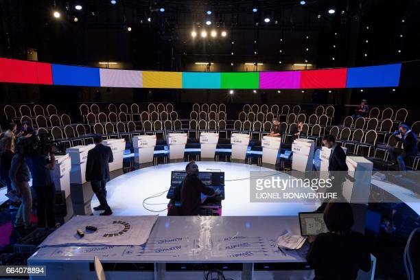 Staff members prepare the TV set of the French TV channel BFM in Aubervilliers outside Paris on April 3 on the eve of a debate between eleven...