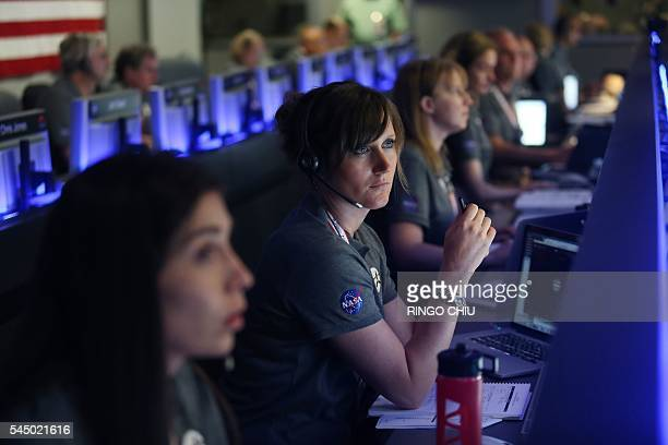 Staff members watch on before the solarpowered Juno spacecraft went into orbit around Jupiter at NASA's Jet Propulsion Laboratory in Pasadena...