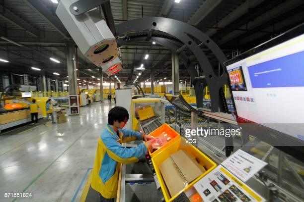 Staff members work at Suning cloud warehouse ahead of the Double 11 global shopping festival on November 7 2017 in Nanjing Jiangsu Province of China...