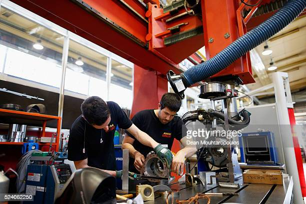 Staff members work in Building 72 the Mechanical Materials Engineering Department or MME workshop at The European Organization for Nuclear Research...