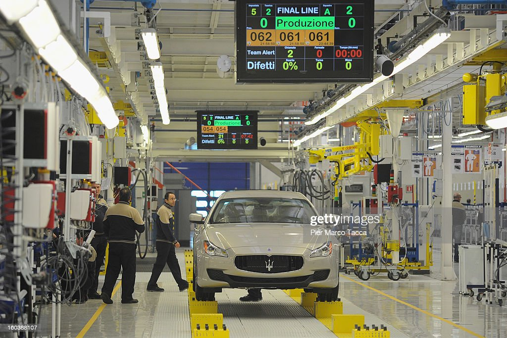Staff members work on the production line at the new Maserati plant during its unveiling in Grugliasco dedicated to Gianni Agnelli on January 30, 2013 in Turin, Italy. The new plant near the company's headquarters in Turin will produce Maserati's new model of luxury saloon cars, the Quattroporte.