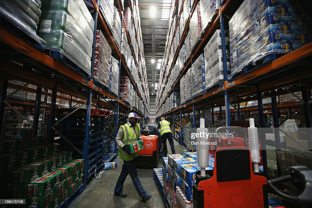 Staff move goods stored at Sainsbury's Waltham Point distribution depot on December 14, 2012 in Waltham Abbey, England. The 700,000 square foot fulfillment factory depot is the largest of 23 operated by Sainsbury's to service their stores. Approximately Twelve hundred people work in the factory which makes over 1800 deliveries a week to around 90 stores in the London, Hertfordshire and Essex region. The depot is gearing up for the final weeks before Christmas, which is the busiest time of the year.