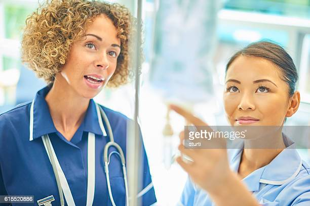 staff nurse advising young nurse