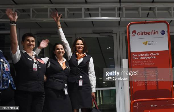Staff of German airline Air Berlin wave goodbye at FranzJosefStrauss airport in Munich southern Germany ahead of the last scheduled flight on October...