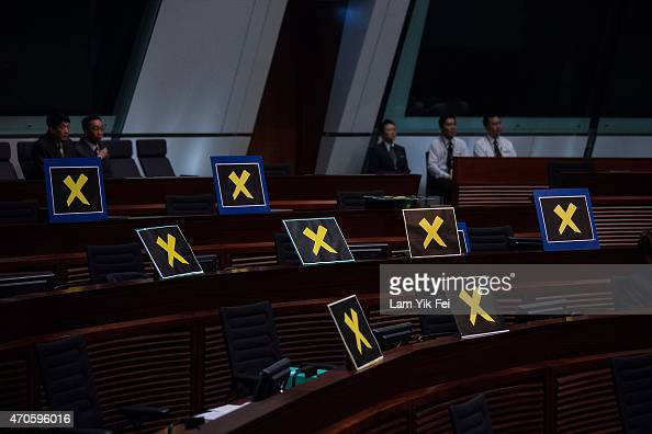 Staff of Legislative Council sit beside placards left by prodemocracy lawmakers after they left to boycott Hong Kong Chief Secretary Carrie Lam...