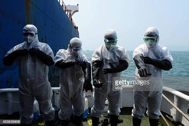 Staff of Qingdao Inspection and Quarantine Bureau do medical inspection to prevent Ebola virus on a cargo ship from epidemic area on August 19 2014...