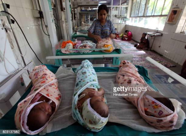 Staff of Sion Ward of hospital which feeds a baby milk donated by mothers in Sion Hospital in Mumbai