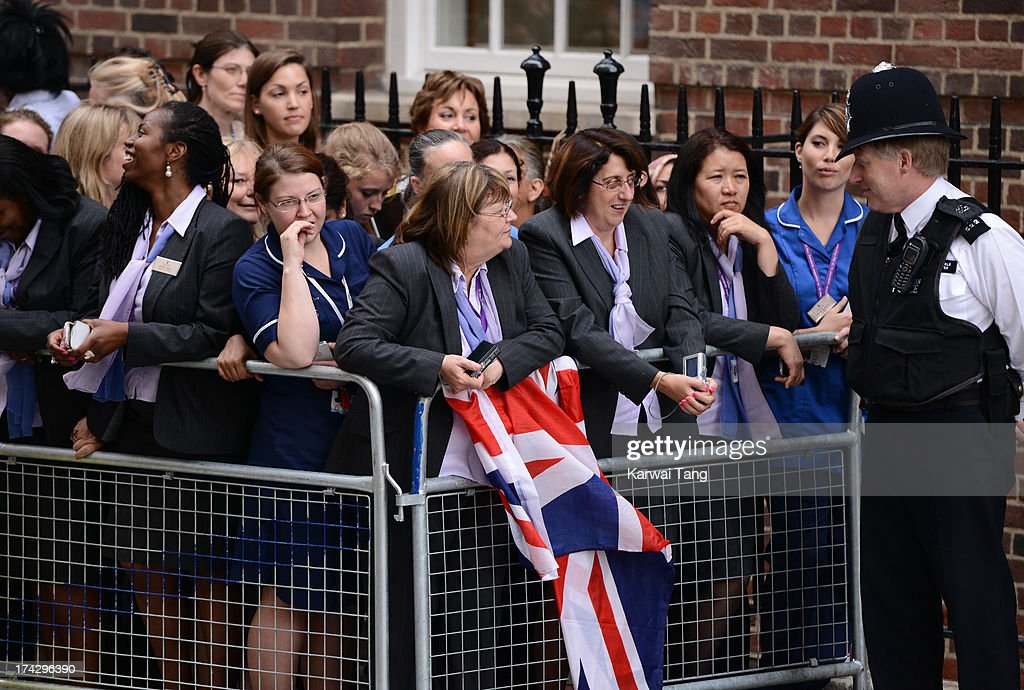 Staff of St Mary's Hospital stand outside the Lindo Wing to cheer as Prince William, Duke of Cambridge and Catherine, Duchess of Cambridge depart with their newborn on July 23, 2013 in London, England. Catherine, Duchess of Cambridge yesterday gave birth to a boy at 16.24 BST and weighing 8lb 6oz, with Prince William, Duke of Cambridge at her side. The baby, as yet unnamed, is third in line to the throne and becomes the Prince of Cambridge.