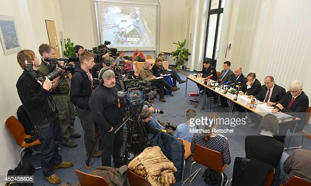 Staff of the Dresden public prosecution and the Dresden Police Department right speak to the media about a recent murder case in which police believe...