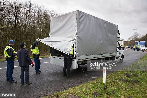 Staff of the Mobile Surveillance Security of the Royal Military Marechaussee and the Dutch national police forces are seen during an inspection of a...