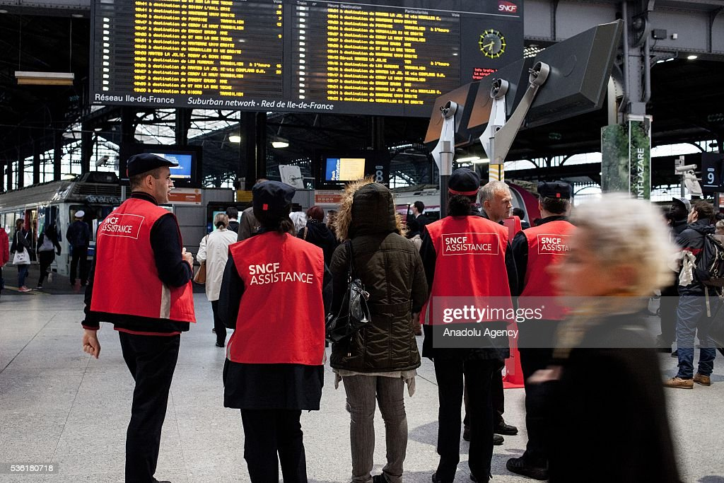 Staff of the SNCF help people with informations about train schedules, trains are delayed or canceled at Paris Saint-Lazare Train Station, Paris, France on May 31, 2016.