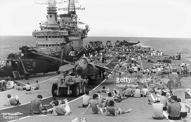 Staff on board HMS Hermes sunbathing on the flight deck as the naval task force heads for the Falkland Islands following the Argentinian invastion...