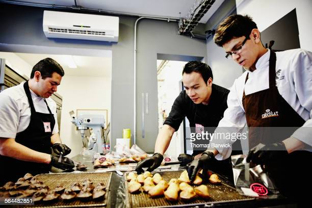 Staff packaging baked goods in chocolate shop