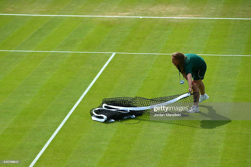 Staff pepare the courts on day four of the Wimbledon Lawn Tennis Championships at the All England Lawn Tennis and Croquet Club on June 30, 2016 in London, England.