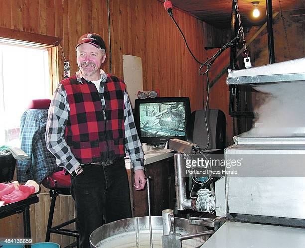 Staff photo by Alan Crowell MAKING MAPLE SYRUP Martin Lariviere monitors the production of maple syrup as sap is boiled down in an evaporator on the...