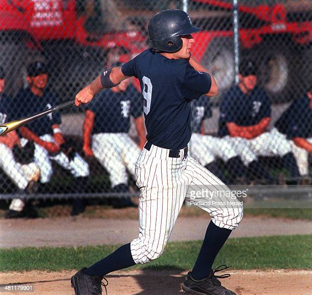 Staff Photo by David MacDonald Tue Jul 03 2001 Travis Anthoine of Andrews raps out a bases loaded single to drive in a run in the 3rd inning against...