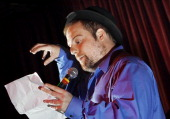 Dan Olney of Portland reads during a poetry slam at the Empire Dine and Dance Photographed on Wednesday July 15 2009