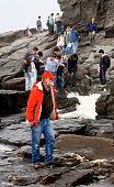 Staff Photo by Doug Jones Thursday June 16 2005 USM Professor Mark Swanson in red leads an international group of geophysicists along a crack/slip...