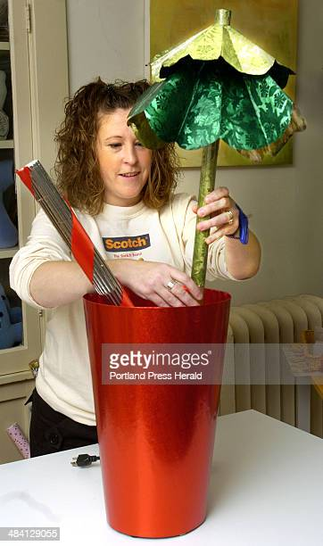 Staff Photo by Doug Jones Tuesday November 23 2004 Holly Karolkowski meets the challenge of wrapping a blender with creative aplomb by disguising it...